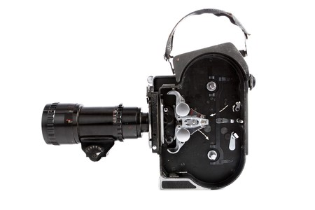 a vintage movie camera isolated on white