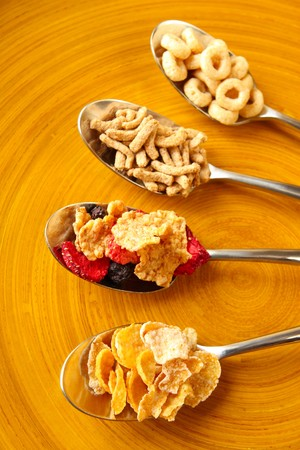 Four spoons that are filled with four types of Breakfast cereal Stock Photo - 4051665