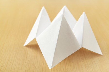 cootie catcher: a folded piece of paper that is made into the shape of a Cootie Catcher Stock Photo