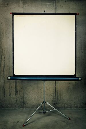 A blank movie screen on a concrete background photo