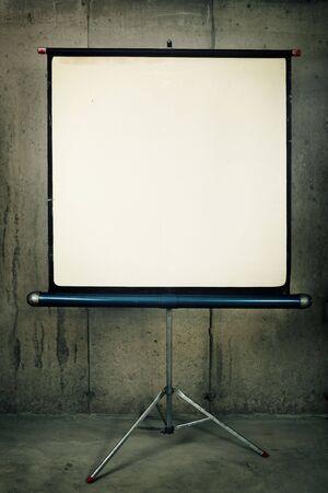 A blank movie screen on a concrete background Reklamní fotografie
