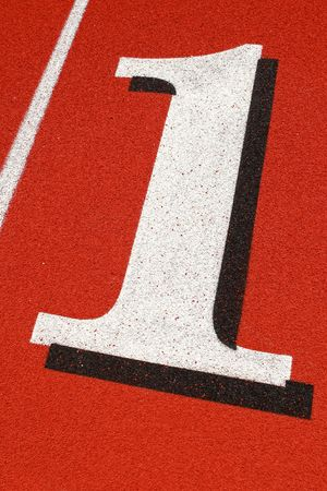 close up of the number one on a red track surface
