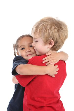 a young boy and girl are hugging
