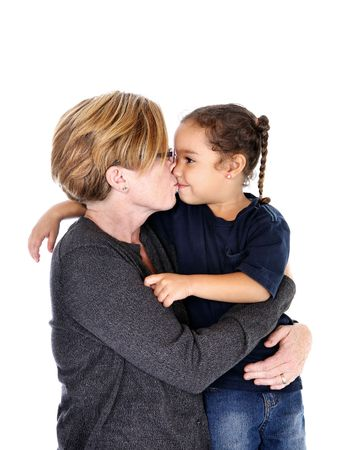 grand daughter: a grandmother kisses her grand daughter Stock Photo