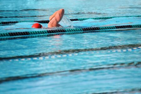 close up of a swimming pool with a swimmer