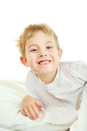 a young boy proudly shows his missing tooth