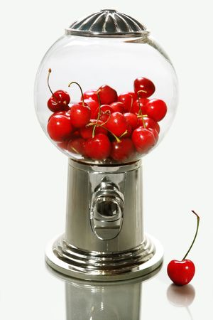 A healthy snack of cherries in a candy dispenser photo
