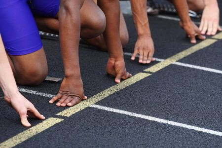 A close up of the hands of runners on the starting line Stock Photo - 5030621