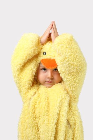 a young boy is dressed up in a chicken costume
