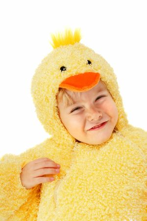 a young boy is dressed up in a chicken costume  photo