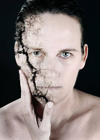 a woman with her face cracking off Stockfoto