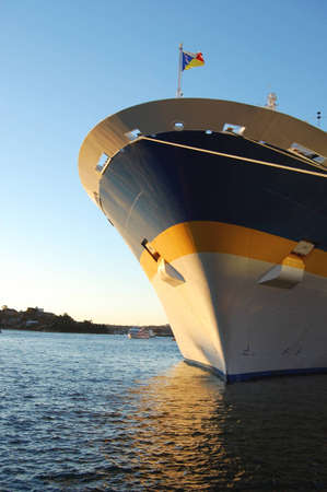 docked: Picture of a passenger cruise liner docked in the harbour. Stock Photo
