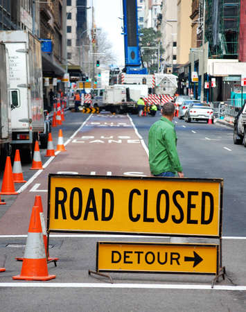 detour: A sign indicates a detour is necessary, as construction work is being carried out ahead