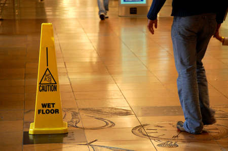ground floor: Caution Wet Floor sign in a shopping mall