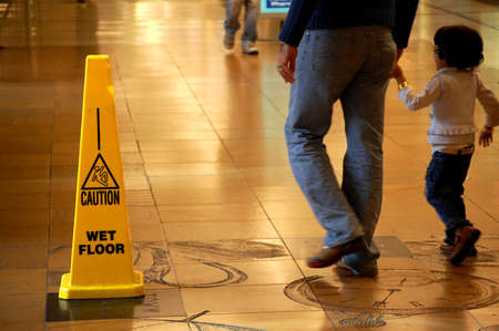 Caution Wet Floor sign in a shopping mall photo