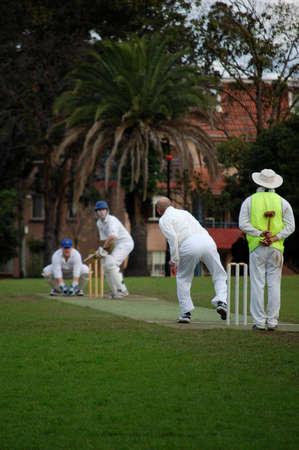 A cricket bowler bowls to a batsman