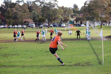 group goals: A corner kick at a womens soccer match on the weekend
