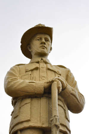 anzac: Statue of an ANZAC soldier on a white background  Photo taken at ANZAC Park, Mareeba, QLD Australia ,This statue is located in a permanently publicly accessible place  As per Australian Copyright law s65, it is thus in the public domain  Stock Photo
