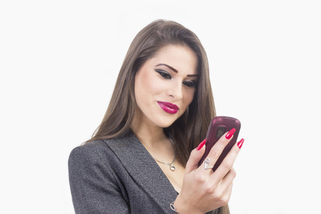 Woman using an app on her smartphone - isolated over white photo