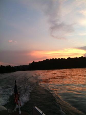 Boat wake in the sunset on Lake Wedowee Al