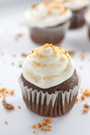 Chocolate cupcakes wirh a buttercream icing and crushed Butterfinger candy on top