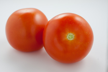 Red ripe tomatoes isolated on a white background
