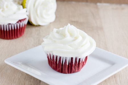 red velvet cupcake: Red Velvet Cupcakes with a white cream cheese icing. Stock Photo