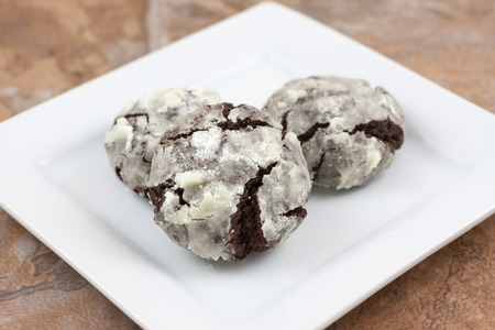 Chocolate crackle cookies with powdered sugar coating. Stock Photo