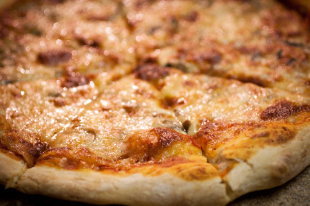 A freshly baked pizza, ready to searve.