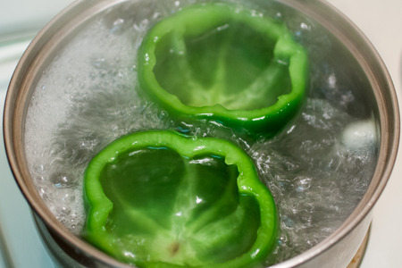 Fresh cut and cleaned bell peppers. Stock fotó