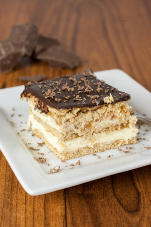 ganache: A layered Boston creme pie style dessert made with french vanilla filling and chocolate ganache topping.
