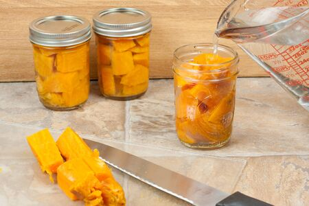 storing: Canning sweat potatoes for storage.