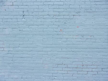 Blue brick wall on inner city building 3
