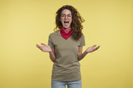 A portrait of brunette screaming crazy woman, she happy abouth something