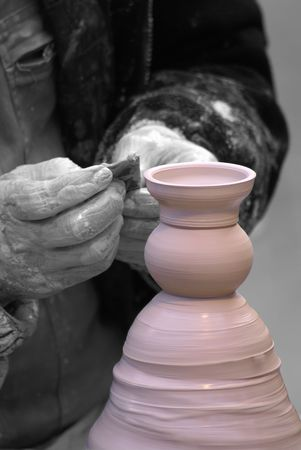 Desaturated pict of a Potter finishing a pink Jar