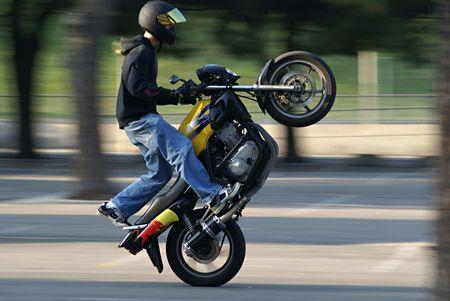 testosterone: Biker Performing A Stunt
