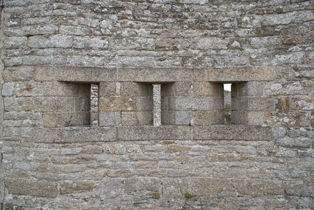 loophole: A view of a stone castle wall, taken while staying in a traditional Brittany city.  Stock Photo
