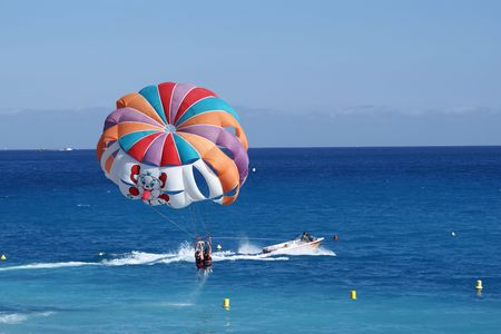 parasailing: a motorboat with parachute prepared for parasailing
