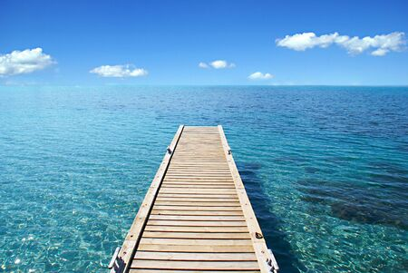noone: View of  the Mediterannean sea from a wood deck. Stock Photo