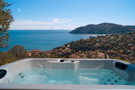 A spa against a view of Mediterranean coast Фото со стока