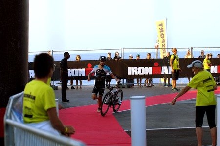 NICE - JULY 27, 2017: IRONMAN Nice 2017. MIKA Tomas finishing the swimming and starting for the 180 km bike tour Redakční