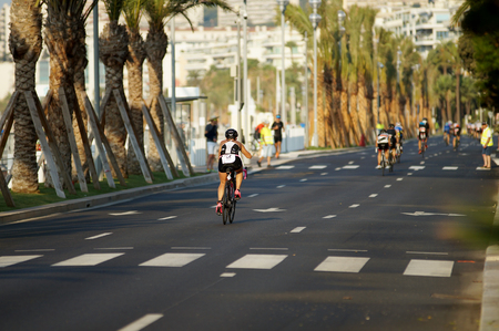 NICE - JULY 27, 2017 : IRONMAN Nice 2017. Competitors starting for the 180 km bike tour. Lisa FUMAGALLI (55) in the foreground