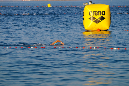 NICE - JULY 27, 2017: IRONMAN Nice 2017. 3,8 km swim in the Mediterranean Sea. CHEVROT arriving first at beach.