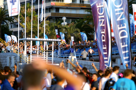 NICE - JULY 27, 2017: IRONMAN Nice 2017. 3,8 km SWIM in the Mediterranean Sea.Denis CHEVROT at the end of the