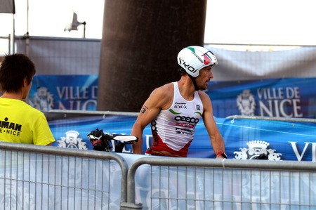 NICE - JULY 27, 2017 : IRONMAN Nice 2017. Alessandro DEGASPERI finishing the swimming and starting for the 180 km bike tour