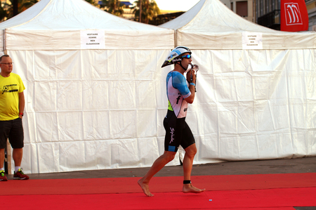 A competitor finishing swimming and preparing for the 180 km bike tour.