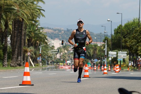NICE - JULY 27, 2017 : IRONMAN Nice 2017. Competitor during the Marathon. Laurent NOBELS (832) close to the 15 km point.