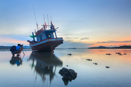 long tailed boat: Photographer take a photo sunrise at the Rawai beach in Phuket, Thailand Stock Photo