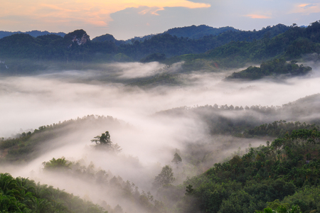generic location: Layer of mountains in the mist at sunrise time.edit warm tone