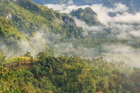 generic location: Layer of mountains in the mist at sunrise time, Baan Nai Wong, Ranong Province, Thailand